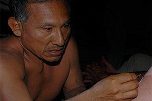 matse shaman administering medicine during ceremony