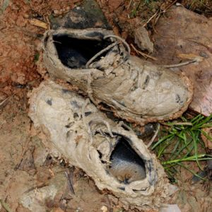 muddy shoes from hiking in amazon rainforest