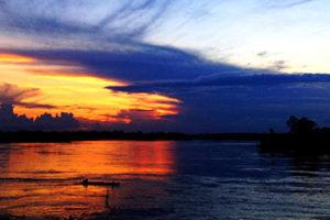 sunset over rio napo in mazan peru