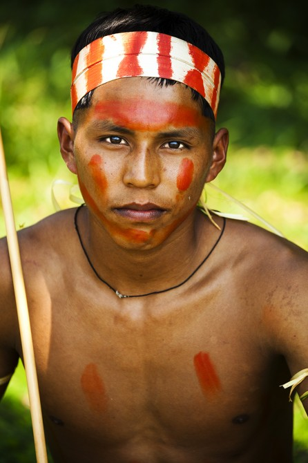 Matsés youth in traditional face paint and dress Alicia Fox Photography