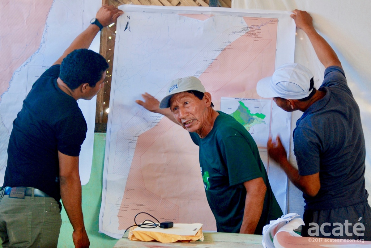 Matsés Elder Arturo at meeting with map