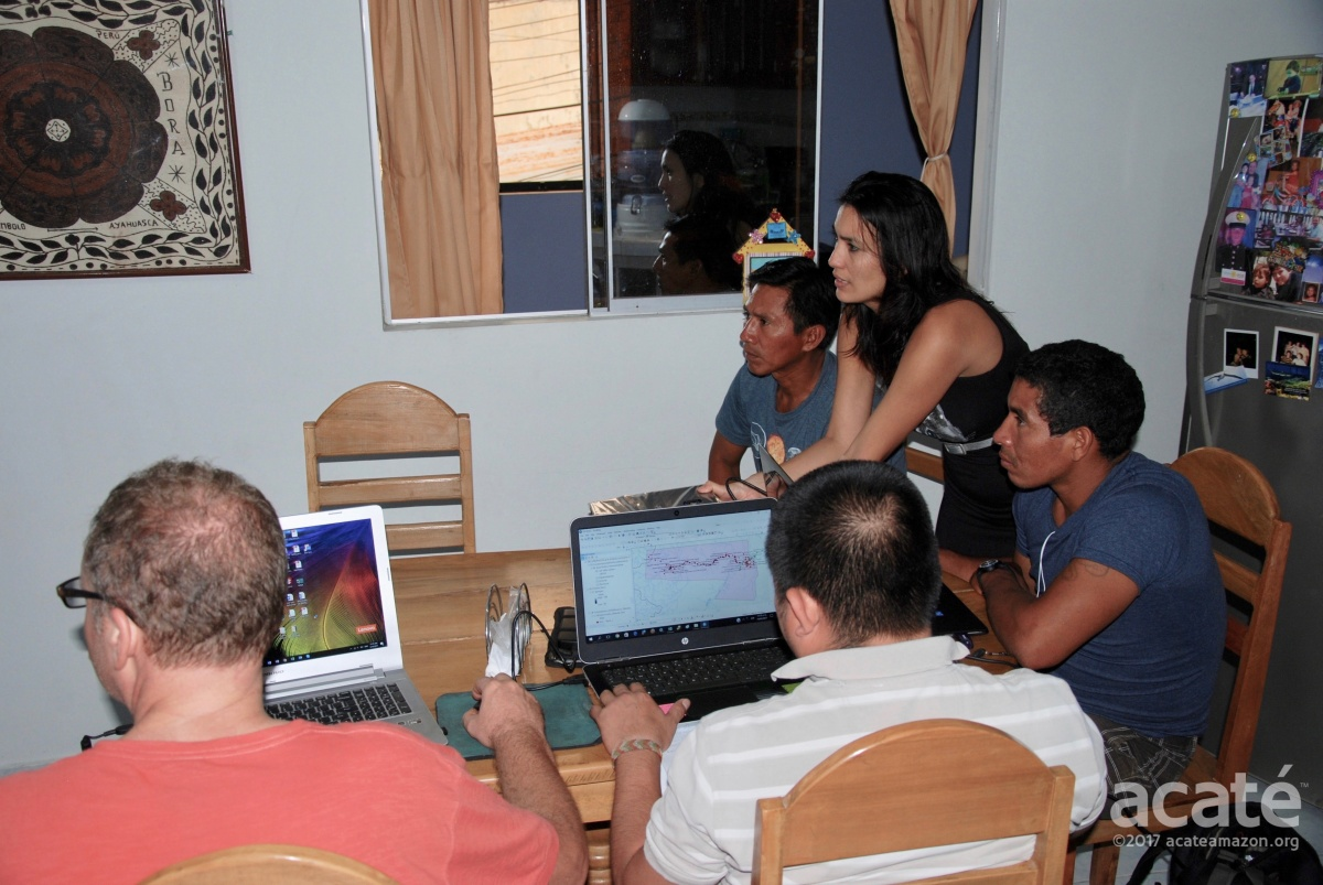 Acaté Co-Founder Bill Park, Carla Noain, Matsés High Chief Wilder Flores, Felipe Bai, and mapping instructor Marcial work late into the night to create the first ancestral maps ©Acaté
